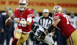 FILE - In this Sunday, Nov. 26, 2017, file photo, San Francisco 49ers quarterback Jimmy Garoppolo rolls out against the Seattle Seahawks during the second half of an NFL football game in Santa Clara, Calif. Garoppolo makes his first start for San Francisco when the 49ers visit the Chicago Bears on Sunday. (AP Photo/John Hefti, File)
