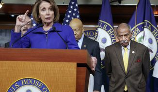 """FILE -- In this file photo from Tuesday, Feb. 14, 2017, House Minority Leader Nancy Pelosi, D-Calif., Rep. John Conyers, D-Mich., right, and other top House Democrats, at a news conference on Capitol Hill in Washington.  Pelosi said today, Thursday, Nov. 30, 2017, that Conyers should resign, saying the accusations are """"very credible.""""  (AP Photo/J. Scott Applewhite, file)"""
