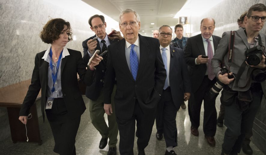 Senate Majority Leader Mitch McConnell, R-Ky., is surrounded by reporters as Republicans work to pass their sweeping tax bill, a blend of generous tax cuts for businesses and more modest tax cuts for families and individuals, on Capitol Hill in Washington, Thursday, Nov. 30, 2017. It would mark the first time in 31 years that Congress has overhauled the tax code, making it the biggest legislative achievement of President Donald Trump's first year in office. (AP Photo/J. Scott Applewhite)