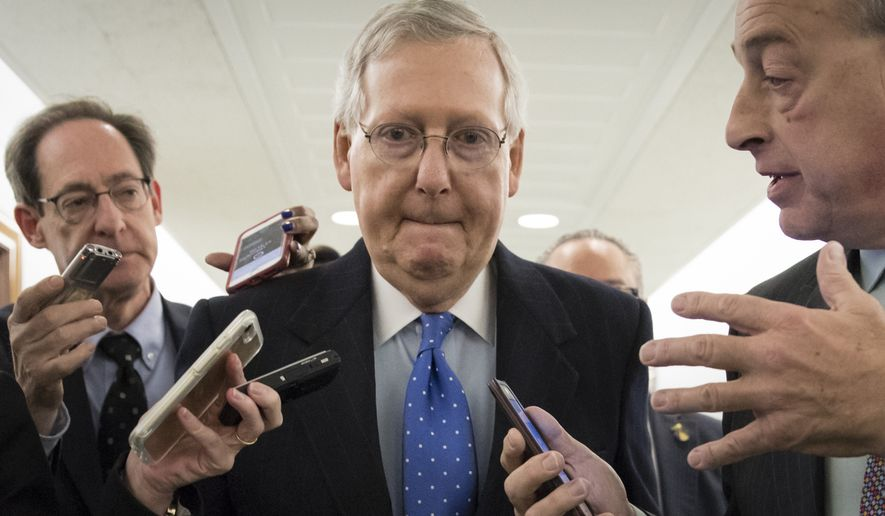"Senate Majority Leader Mitch McConnell was working with the Republican rank and file to pass their sweeping tax bill on Thursday until their ""trigger"" plan got derailed. (Associated Press)"