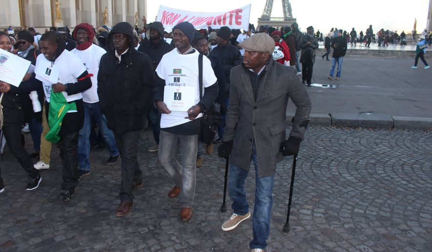 Thomas Ndiaye (right) leads Mauritanian exiles who have been protesting the past month in Paris, calling for an end to human bondage in a country rated among worst in the world for slavery. (Geoff Hill/Special to The Washington Times)