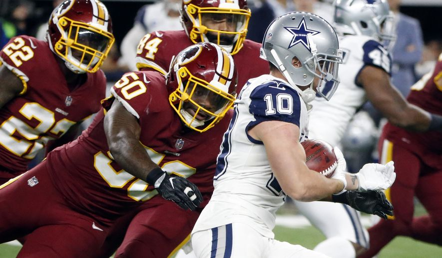 Washington Redskins linebacker Martrell Spaight (50) is unable to stop Dallas Cowboys wide receiver Ryan Switzer (10) from returning a punt for a touchdown in the first half of an NFL football game, Thursday, Nov. 30, 2017, in Arlington, Texas. (AP Photo/Michael Ainsworth)