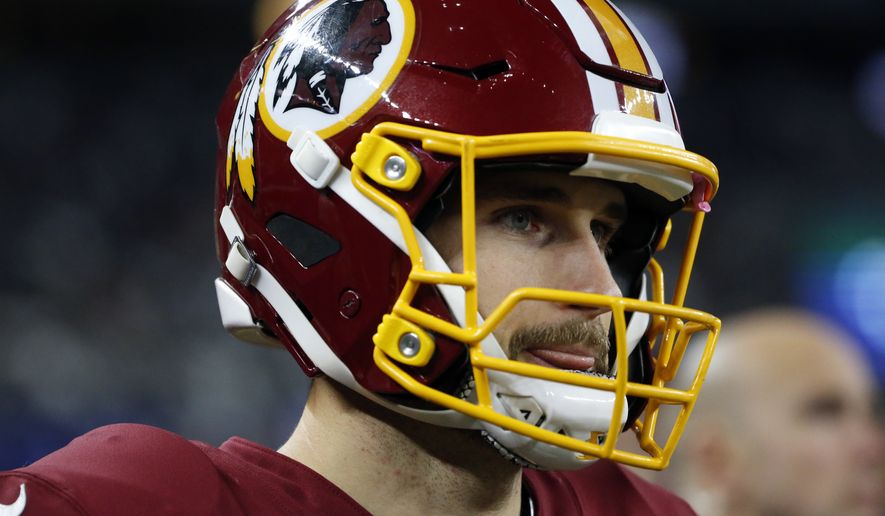 Washington Redskins quarterback Kirk Cousins watches play from the sideline in the second half of an NFL football game against the Dallas Cowboys on Thursday, Nov. 30, 2017, in Arlington, Texas. (AP Photo/Michael Ainsworth)