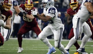 Dallas Cowboys running back Alfred Morris (46) looks for running room as he carries the ball against the Washington Redskins in the second half of an NFL football game, Thursday, Nov. 30, 2017, in Arlington, Texas. (AP Photo/Michael Ainsworth)