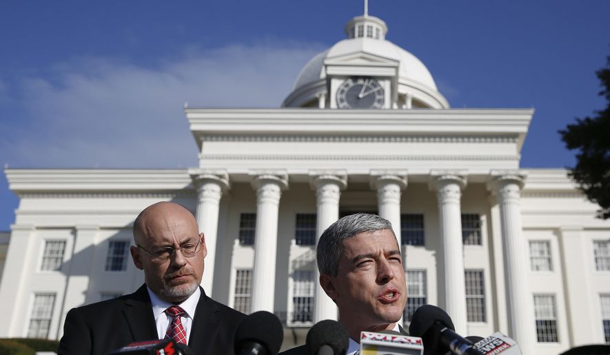 In this Tuesday, Nov. 21, 2017, file photo, Ben DuPre, right, Dean Young, left speaks at a news conference in Montgomery, Ala. DuPre and Young are part of a small group of longtime allies that is at the forefront defending Alabama Senate candidate Roy Moore amid sexual misconduct claims. (AP Photo/Brynn Anderson, File)