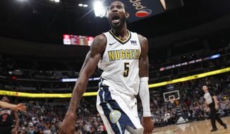 Denver Nuggets guard Will Barton celebrates after hitting the winning basket against the Chicago Bulls in an NBA basketball game Thursday, Nov. 30, 2017, in Denver. The Nuggets won 111-110. (AP Photo/David Zalubowski)