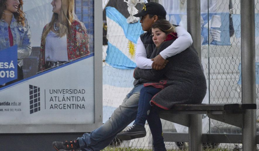 Relatives of crew members from the missing ARA San Juan submarine hug outside the navy base in Mar del Plata, Argentina, Thursday, Nov. 30, 2017. Argentina has ended a rescue operation for 44 crew members aboard the submarine that went missing on Nov. 15, but it will continue the search for the sub. (AP Photo/Marina Devo)