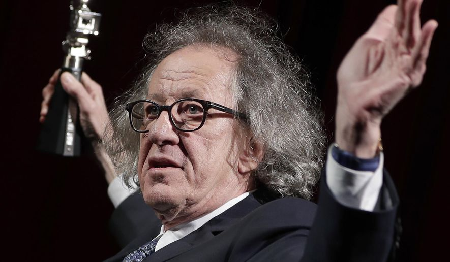 """FILE - In this Feb. 11, 2017 file photo, Australian actor Geoffrey Rush poses with his 'Berlinale Camera Award' wich he received prior to the screening of the film 'Final Portrait' at the 2017 Berlinale Film Festival in Berlin, Germany. The Sydney Theatre Company says it received a complaint of """"inappropriate behavior"""" against Rush, an allegation lawyers for the Oscar winner denied. The company wasn't disclosing details of the behavior alleged to have occurred while the 66-year-old Australian actor was an employee. Media reports say the allegation dated from the theater's production of """"King Lear,"""" about two years ago. His lawyers deny Rush was involved in inappropriate behavior. (AP Photo/Michael Sohn, File)"""