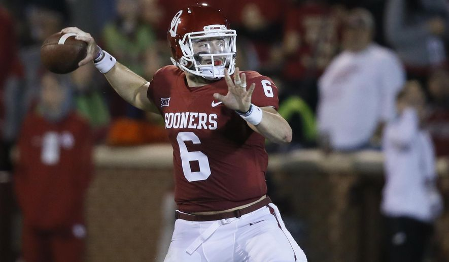 FILE - In this Nov. 11, 2017, file photo, Oklahoma quarterback Baker Mayfield (6) throws in the second quarter of an NCAA college football game against TCU, in Norman, Okla. Oklahoma and TCU meet in the Big 12 Championship on Saturday, Dec. 2, 2017. (AP Photo/Sue Ogrocki, File)