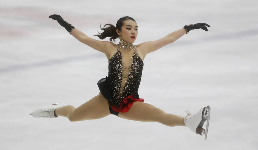 "In this Saturday, Sept. 16, 2017 file photo, United States' Karen Chen competes during the free skate at the U.S. International Figure Skating Classic in Salt Lake City. Karen Chen's autobiography just hit the book shelves. The defending U.S. women's figure skating champion authored the book ""Finding the Edge"" with the help of Natalie England over the past few months. (AP Photo/Rick Bowmer, File)"