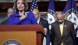 """In this file photo from Tuesday, Feb. 14, 2017, House Minority Leader Nancy Pelosi, D-Calif., Rep. John Conyers, D-Mich., right, and other top House Democrats, speak at a news conference on Capitol Hill in Washington. Pelosi said Thursday, Nov. 30, 2017, that Conyers should resign, saying the accusations are """"very credible.""""  (AP Photo/J. Scott Applewhite, file)"""