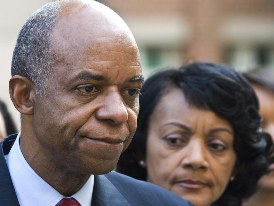FILE - In this Aug. 5, 2009, file photo, former Louisiana congressman William Jefferson, left, stands outside the Albert V. Bryan Courthouse with his wife, Andrea after being convicted on 11 of 16 counts in Alexandria, Va. Federal prosecutors and lawyers for Jefferson, who famously hid $90,000 in his freezer, are working on an agreement for his resentencing on corruption charges, according to court documents filed in the case.  (AP Photo/Kevin Wolf, File)
