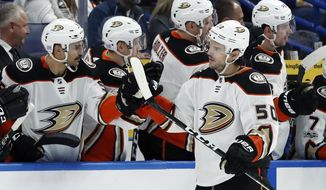 Anaheim Ducks' Antoine Vermette (50) is congratulated by teammates after scoring during the second period of an NHL hockey game against the St. Louis Blues on Wednesday, Nov. 29, 2017, in St. Louis. (AP Photo/Jeff Roberson)