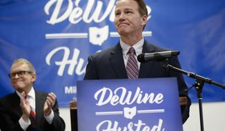 Ohio Secretary of State Jon Husted, right, pauses as he speaks alongside Ohio Attorney General and former U.S. Sen. Mike DeWine, left, during a news conference at the University of Dayton to announce their decision to share the ticket in their bid for the Ohio governorship, Thursday, Nov. 30, 2017, in Dayton, Ohio. (AP Photo/John Minchillo)