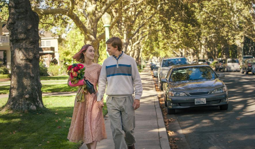 "This image released by A24 Films shows Saoirse Ronan, left, and Lucas Hedges in a scene from ""Lady Bird."" The film, directed by Greta Gerwig, was named best picture by the New York Film Critics Circle Awards on Thursday, Nov. 30. (Merie Wallace/A24 via AP)"