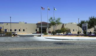 FILE - This May 19, 2015, file photo shows the Adelanto Detention Facility in Adelanto, Calif. The facility is where Saliou Ndiaye an asylum-seeker from Senegal was held and released from after a reported suicide attempt. Ndiaye's attorney Carrye Washington wants the U.S. government to take him back into custody and oversee his medical care. (James Quigg/The Daily Press via AP, File)