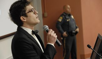 """In this Nov. 28, 2017 photo, Lucian Wintrich, White House correspondent for the right-wing blog Gateway Pundit, speaks at the University of Connecticut in Storrs, Conn. The conservative commentator was arrested and charged with breach of peace after an altercation during his speech titled """"It's OK To Be White."""" (Rebecca Lurye/The Courant via AP)"""