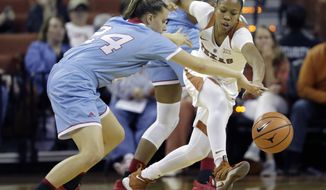 Texas guard Alecia Sutton (1) steals the ball from Louisiana Tech guard Taylor Stahly (24) during the first half of an NCAA college basketball game, Thursday, Nov. 30, 2017, in Austin, Texas. (AP Photo/Eric Gay)