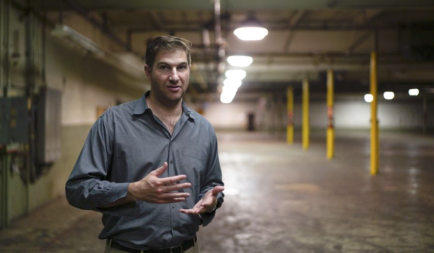 File- This July 13, 2017, file photo shows Daniel Kessler, a plastics businessman, gesturing in a former toy factory in Youngstown, Ohio. Ohio selected 12 large growers to participate in its medical marijuana program Thursday, Nov. 30, 2017, in a competitive process that quickly drew a prospective legal challenge. In announcing the large cultivators and a final small grower, the state rounded out the list of 24 companies authorized to produce medicinal crops under a new system expected to go live by September. Kessler's Riviera Creek Holdings LLC was one of the growers selected. (AP Photo/Dake Kang, File)