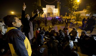 People condemn an attack on a Shiite mosque in Islamabad, Pakistan, Wednesday, Nov. 29, 2017. Pakistani police say gunmen have opened fire at the main gate of a Shiite mosque in the capital Islamabad killing a worshipper and wounding three others. (AP Photo/B.K. Bangash)