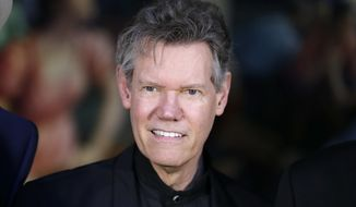 FILE - In this March 29, 2016 file photo, country singer Randy Travis attends the announcement of the Country Music Hall of Fame inductees in Nashville, Tenn. A federal judge has denied a request by country singer Randy Travis to stop the state of Texas from releasing footage of him naked and ranting during a 2012 DUI arrest. The ruling on a request for an injunction issued Thursday, Nov. 30, 2017, paves the way for the Texas Department of Safety to release the footage on Friday, which was requested through an open records request. (AP Photo/Mark Humphrey, File)