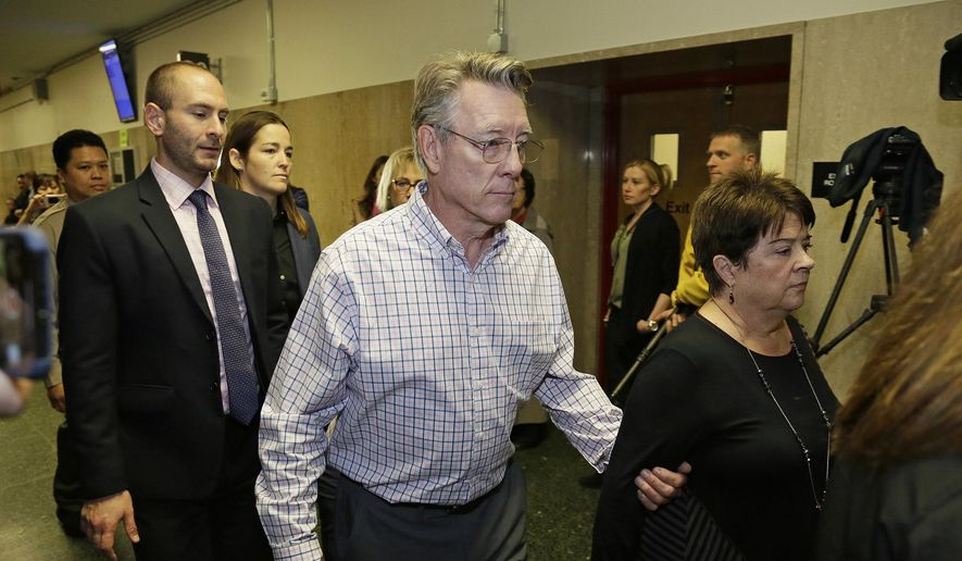 In this Nov. 30, 2017 file photo, Jim Steinle, center, and Liz Sullivan, right, the parents of Kate Steinle, walk to a courtroom for closing arguments in the trial of Jose Ines Garcia Zarate accused of killing their daughter, in San Francisco. (AP Photo/Eric Risberg, File)