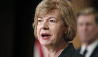 FILE - In this April 25, 2017 file photo, Sen. Tammy Baldwin, D-Wis., speaks on Capitol Hill in Washington. For the second time in as many weeks, Baldwin is giving away donations she received from someone accused of sexual misconduct. Baldwin's campaign on Wednesday night, Nov.  29 said it was donating the $5,350 she had received from public radio personality Keillor since 2012 to the Bolton Refuge House in Eau Claire. The move comes after Baldwin two weeks ago donated $20,000 she received from fellow Democratic Sen. Al Franken's political action committee to the Women Veterans Initiative. (AP Photo/Alex Brandon, File)