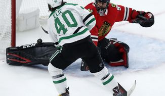 Dallas Stars' Remi Elie scores on Chicago Blackhawks' Corey Crawford during the second period of an NHL hockey game Thursday, Nov. 30, 2017, in Chicago. (AP Photo/Jim Young)