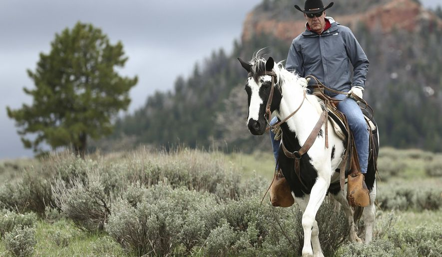 FILES - In this May 9, 2017, file photo, Interior Secretary Ryan Zinke rides in the Bears Ears National Monument with local and state representatives in Blanding, Utah. President Donald Trump will announce plans next week to shrink two sprawling Utah national monuments by nearly two-thirds, reversing actions taken by Democrat Barack Obama after a years-long push by tribal leaders and environmental groups. Leaked documents obtained by The Associated Press show that Trump plans to shrink Bears Ears National Monument by nearly 85 percent and reduce Grand Staircase-Escalante National Monument by almost half.  (Scott G Winterton/The Deseret News via AP)