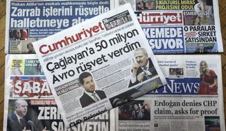 "Front pages of some of Turkish newspapers with headlines concerning a trial in New York against a Turkish banker charged with violating U.S. sanctions against Iran, in Ankara, Turkey, Thursday, Nov. 30, 2017. Turkish-Iranian gold trader Reza Zarrab has testified Wednesday during the trial that he bribed former economy minister Zafer Caglayan. The headlines read: ""I gave 50 million Euros to Caglayan,"" ""Zarrab speaks at trial,"" ""Zarrab is used to bribing."" (AP Photo/Burhan Ozbilici)"