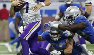 FILE - In this Nov. 23, 2017, file photo, Minnesota Vikings quarterback Case Keenum rushes for a 9-yard touchdown during the first half of an NFL football game against the Detroit Lions, in Detroit. The Vikings could take another big step in their bid to run away with the NFC North on Sunday when they match their seven-game winning streak against the Atlanta Falcons, who have won three straight. (AP Photo/Jeff Haynes, File)
