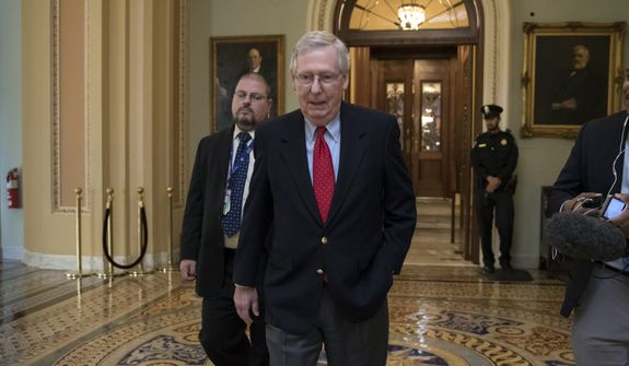 Senate Majority Leader Mitch McConnell, R-Ky., walks from the chamber to his office as the GOP overhaul of the tax bill nears a vote, on Capitol Hill in Washington, Friday, Dec. 1, 2017. (AP Photo/J. Scott Applewhite)