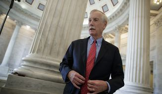 Sen. Angus King, I-Vt., does a TV news interview on Capitol Hill in Washington, Friday, Dec. 1, 2017. (AP Photo/J. Scott Applewhite) ** FILE **