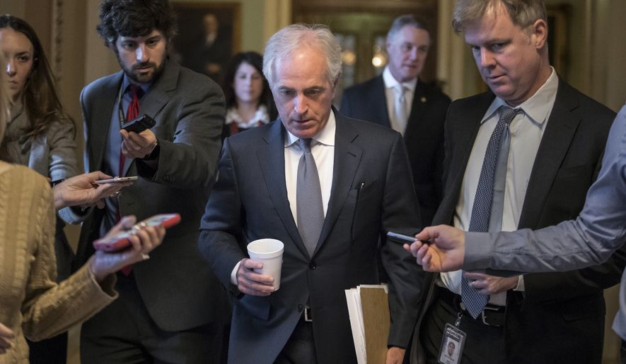 Sen. Bob Corker, R-Tenn., is pursued by reporters as Republican senators gather to meet with Senate Majority Leader Mitch McConnell, R-Ky., on the stalled GOP effort to overhaul the tax code, on Capitol Hill in Washington, Friday, Dec. 1, 2017. (AP Photo/J. Scott Applewhite)