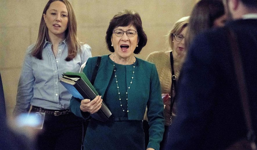 Sen. Susan Collins, R-Maine, center, arrives as Republican senators gather to meet with Senate Majority Leader Mitch McConnell, R-Ky., on the GOP effort to overhaul the tax code, on Capitol Hill, Friday, Dec. 1, 2017, in Washington. (AP Photo/Andrew Harnik)