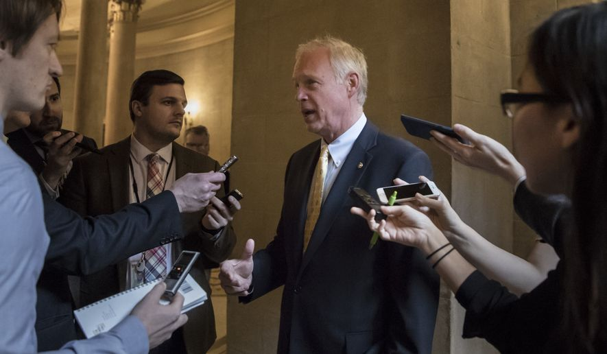 Sen. Ron Johnson, R-Wis., pauses for reporters as Republican senators gather to meet with Senate Majority Leader Mitch McConnell, R-Ky., on the stalled GOP effort to overhaul the tax code, on Capitol Hill in Washington, Friday, Dec. 1, 2017. (AP Photo/J. Scott Applewhite) ** FILE **