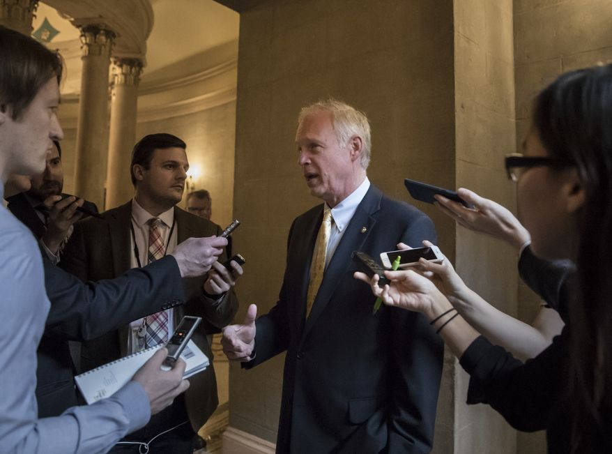 Sen. Ron Johnson, R-Wis., pauses for reporters on Capitol Hill in Washington, Friday, Dec. 1, 2017. (AP Photo/J. Scott Applewhite) ** FILE **