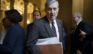 Sen. John Kennedy, R-La., followed by Sen. Pat Toomey, R-Pa., arrives as Republican senators gather to meet with Senate Majority Leader Mitch McConnell, R-Ky., on the tax code overhaul, on Capitol Hill in Washington, Friday, Dec. 1, 2017. (AP Photo/J. Scott Applewhite) ** FILE **