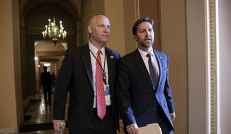 President Donald Trump's Legislative Director Marc Short, left, walks with Sen. Ben Sasse, R-Neb., after a closed-door meeting of Republican lawmakers to advance the GOP overhaul of the tax code, on Capitol Hill in Washington, Friday, Dec. 1, 2017. (AP Photo/J. Scott Applewhite) ** FILE **