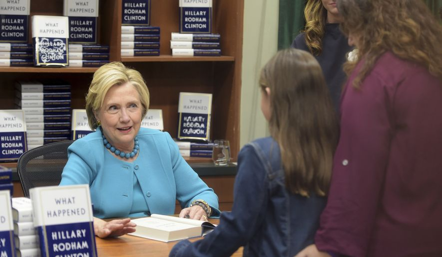 "Hillary Clinton signs copies of her book, ""What Happened,"" at Vroman's Bookstore in Pasadena, Calif., Friday, Dec. 1, 2017. (Walt Mancini/Los Angeles Daily News via AP)"