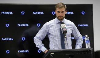 Washington Redskins' Kirk Cousins responds to a reporters question during a news conference after an NFL football game against the Dallas Cowboys on Thursday, Nov. 30, 2017, in Arlington, Texas. (AP Photo/Michael Ainsworth)