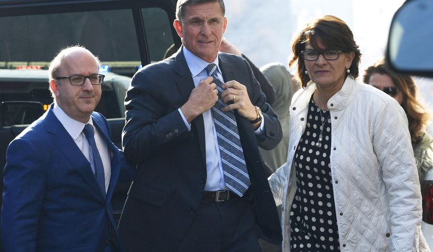 Former Trump national security adviser Michael Flynn, center, arrives at federal court in Washington, Friday, Dec. 1, 2017. Court documents show Flynn, an early and vocal supporter on the campaign trail of President Donald Trump whose business dealings and foreign interactions made him a central focus of Mueller's investigation, will admit to lying about his conversations with Russia's ambassador to the United States during the transition period before Trump's inauguration.  (AP Photo/Susan Walsh)