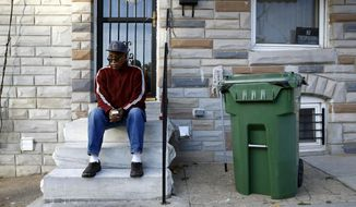"""In this Nov. 27, 2017 photo, Harold Perry sits on a stoop in front of his home, across the street from the site of Freddie Gray's arrest, in the Sandtown-Winchester neighborhood of Baltimore. These days, it's hard to find anyone in this neighborhood of generational poverty and disenfranchisement who admits to believing that police involved Gray's arrest might somehow be held responsible. """"There was never going to be any justice,"""" Perry said bitterly. """"Maybe someone had hopes once upon a time, but justice is a very hard thing to come by around here."""" (AP Photo/Patrick Semansky)"""
