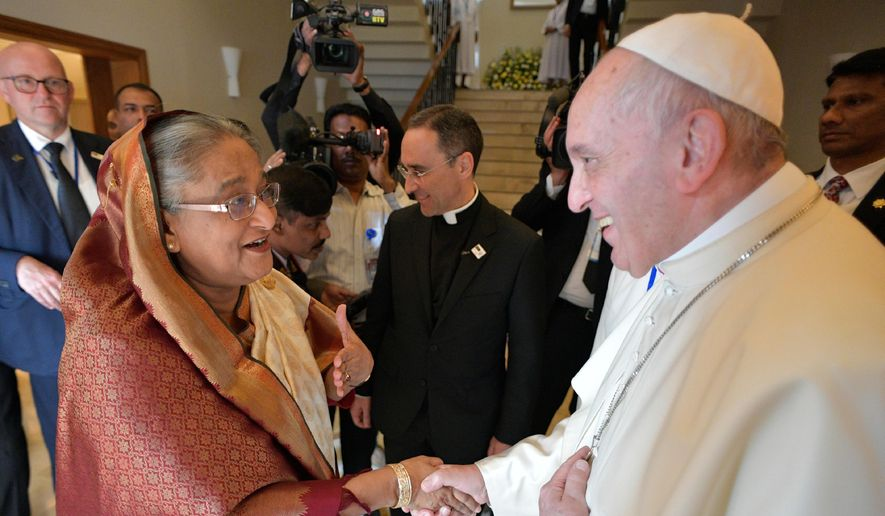 Bangladeshi Prime Minister Sheikh Hasina, left, meets Pope Francis at the Apostolic Nunciature, in Dhaka, Bangladesh, Friday, Dec. 1, 2017.  (L'Osservatore Romano/Pool Photo via AP)