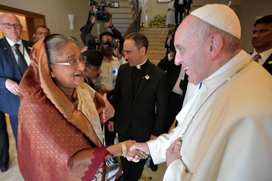 Bangladeshi Prime Minister Sheikh Hasina, left, meets Pope Francis at the Apostolic Nunciature, in Dhaka, Bangladesh, Friday, Dec. 1, 2017.  (L'Osservatore Romano/Pool Photo via AP)