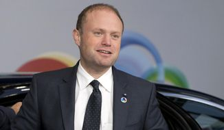 FILE -  In this file photo dated Friday, Nov. 24, 2017, Malta's Prime Minister Joseph Muscat arrives for an Eastern Partnership Summit in Brussels.  Muscat welcomed EU lawmakers on a fact finding mission to Malta, Friday Dec. 1, 2017, telling them about reforms made in Malta, though European Parliament members sharply criticized the implementation of laws meant to combat money laundering in Malta. (AP Photo/Virginia Mayo, FILE)