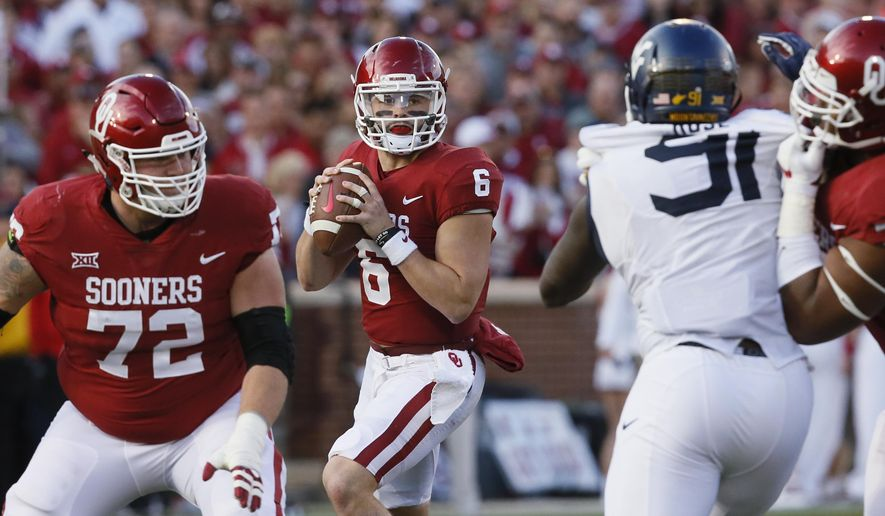 In this Saturday, Nov. 25, 2017. file photo, Oklahoma quarterback Baker Mayfield (6) prepares to pass in the second quarter of an NCAA college football game against West Virginia in Norman, Okla.  Oklahoma could already be playoff bound, except Heisman Trophy front-runner Baker Mayfield and the No. 2 Sooners have to play in the revived Big 12 championship game and beat No. 10 TCU for the second time in four weeks. (AP Photo/Sue Ogrocki, File)