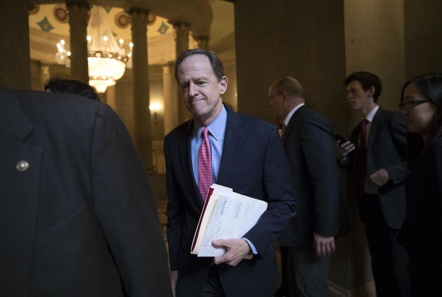 Sen. Pat Toomey, R-Pa., a member of the tax-writing Senate Finance Committee, and other Republican senators gather to meet with Senate Majority Leader Mitch McConnell, R-Ky., on the GOP effort to overhaul the tax code, on Capitol Hill in Washington, Friday, Dec. 1, 2017. (AP Photo/J. Scott Applewhite)