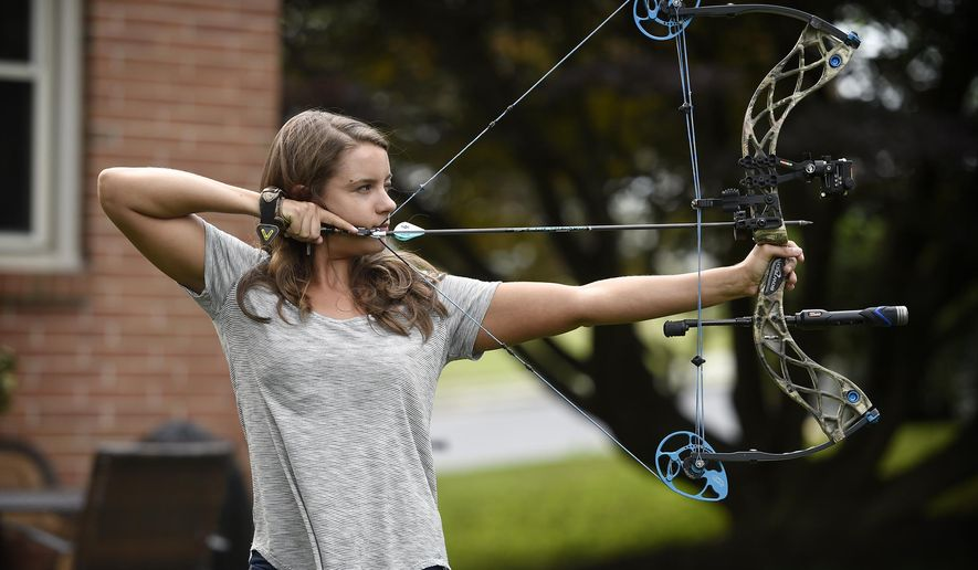 Bowhunter and Cleona native Emily Kantner is living her dream. The Lebanon Valley College graduate is being paid to hunt, and write about her experiences for Petersen's Bowhunting magazine. Kanter demonstrates her bowhunting technique at her Cleona home. (Michael K. Dakota/Lebanon Daily News via AP)