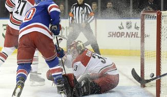 New York Rangers right wing Michael Grabner (40) scores a goal past Carolina Hurricanes goalie Scott Darling (33) during the second period of an NHL hockey game Friday, Dec. 1, 2017, at Madison Square Garden in New York. (AP Photo/Bill Kostroun)